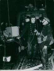 1946  Firemen in the street receiving instructions from men in the Blazing Building, by means of walkie talkie, used for the first time in the fire fighting action.