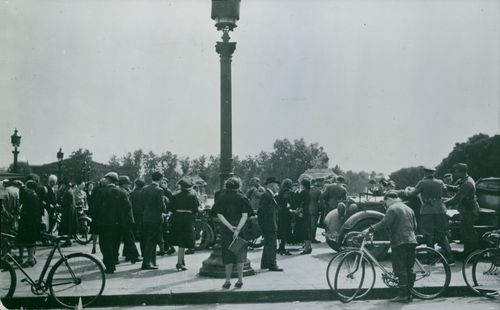 Vintage photo of French soldiers and civilians in the street of Paris.