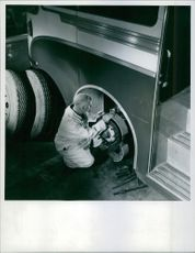 This operator, in Ferodo research laboratories at Chapel-en-le-Frith, on the test bus is connecting thermocouple leads from experimental linings to the wiring of an instrument in the passenger compartment, which indicates lining temperature while it is on