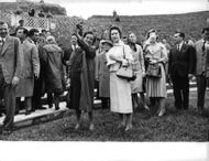 Woman pointing something out for Princess Margaret on visit to Rome.