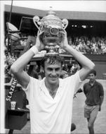 John Newcombe (Australia) poses with his cup after winning the Wimbledon Championship