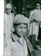 A Yemeni boy, in the attire of a soldier carrying gun during the civil war in Yemen.  - Nov 1962