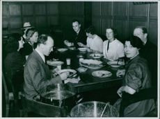 People eating on a table.