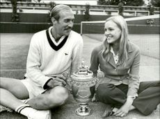 Tennis player Stan Smith along with Marjorie Gengler and his trophy after the win during Men's Singles Championship.