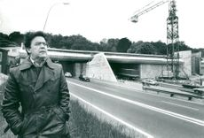 Bengt Olson, artist, in front of his work of art on the Tunnel de Saint-Cloud