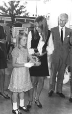 Astrid of Belgium holding flowers with mother Paola.