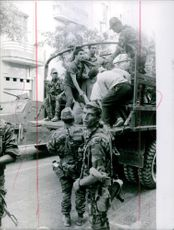 People being shifted in a military vehicle during Bizerte crisis, 1961.
