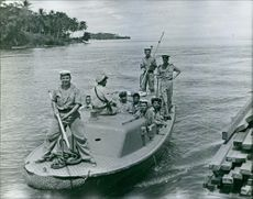 A group of sailors on a boat in New Guinea. March 28, 1962.