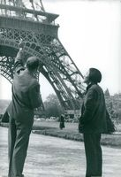 A man pointing the tower to a man.  - Jul 1960