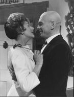 Yul Brynner romancing with a woman.
