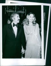 Smiling Cheryl Kennedy stood holding hands with her companion, 1971.