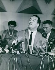 Kaid Ahmed giving speech on mike.  1965