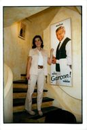 Yves Montand's wife Carole Amiel shows a painting of the lost husband at a memorial exhibition in southern France