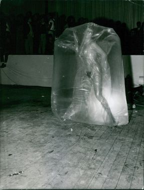 A performer inside a plastic wrap.