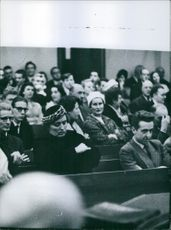People siting in the assembly. 1960