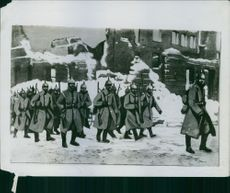 An illustration of a detachment of German troops advancing in the wake of the Russians through Mlava.