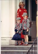 Princess Diana waves by Prince William and Prince Harry