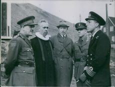 Left to right - brigadier Potts, Commanding Force on all land operations with the Norwegian pastor, Norwegian detachment. 1941.