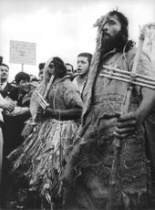 Men wearing clothes made of sacks and dried leaves during Pope Paul VI's visit.  - Sep 1968