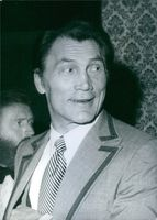 Close up of American actor and singer Jack Palance, while he have looked at somewhere with smiling face