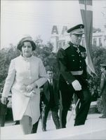 A photo of Brigadier Stylianos Pattakos and his wife walking.