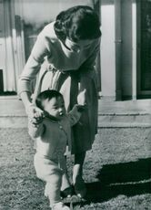 Prince Hiro with his mother, princess Michiko out in the garden
