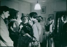 People in a party standing and talking, 1956.