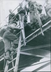 Norwegian soldier taking position on top of the bridge. 1940