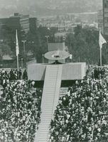 An athlete  lights the cauldron in the stadium to start the Olympic games.