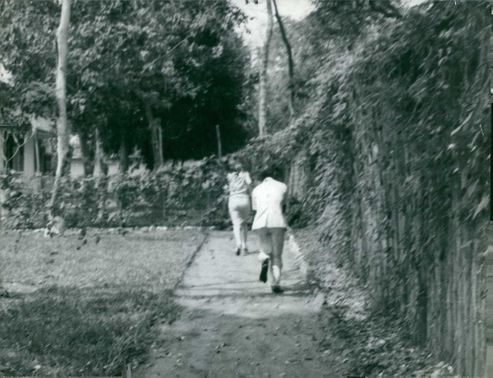 Two people running.  - 1962