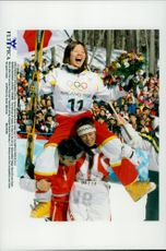Tea Satoya is released by teammates after the gold medal in freestyle skiing during the Winter Olympics 1998.
