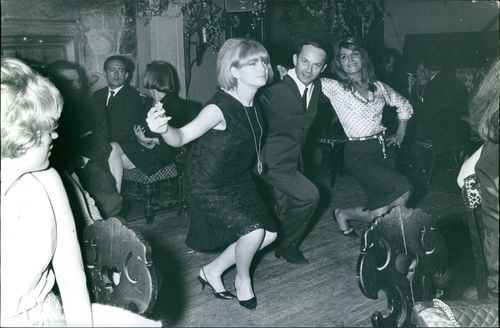 A MAN DANCING WITH THE LADIES