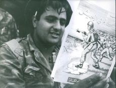 "A soldier reading a comic book about soldiers during the war in Israel.  ""Israel"""