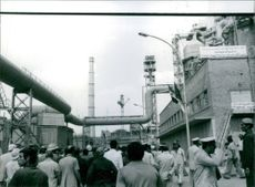 Workers arriving at the iron and steel complex at Hellwan, south of Cairo. The complex begun in 1954 with Soviet and West German help. There are vast deposits of iron ore at the Aawan and Bahris oases which supply the furnaces. The development of this vit