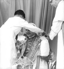 A man wearing cloth on Pope Paul VI.