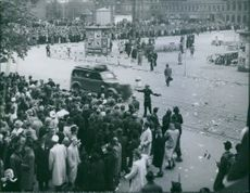 Peace 1945 A Free North Swedish servicemen holding back the crowd during wartime in 1945.