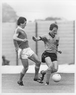 George Burley and Mel Eves are fighting for the ball