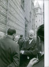 People gathered in street and having fun while talking to each other along with The King in France in 1963