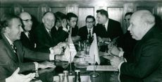 Gerald Rudolph Ford sitting with people in Moscow.