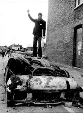 Cars were rolled and burned during the riot in Brixton.