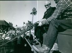 Barry Goldwater learning horse cart riding.  1964