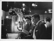 Dana Wynter reading a script while shooting.