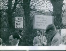 Citizens are raising their sign board during the protest. 1964