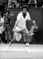 American tennis player Arthur Ashe during the semi-final of the men's single against Tony Roche at Wimbledon 1975