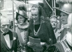 Princess Maria Gabriella surrounded by people.