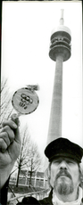 Man with an Olympic club before the 1972 Olympic Games