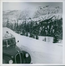 A car travelling on snowy mountains in Norway. 1940