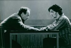 Writer Terry George and actor Aidan Gillen talking on the set of the 1996 film Some Mother's Son.