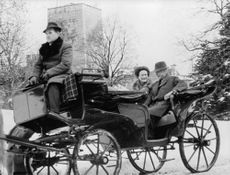 The Duke and Duchess of Windsor enjoying a chariot ride.