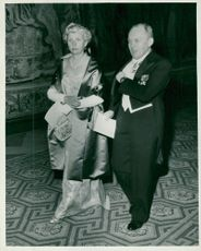 Director Henning Throne-Holst with spouse heading for dinner